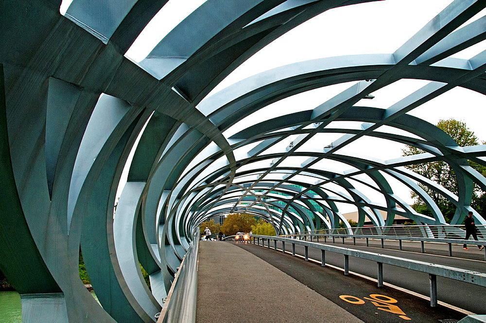 bridge crossing Arve river in Geneva named after Hans Wilsdorf, the founder of Rolex, bridge is called 'bird's nest' because of its interwoven girders.
