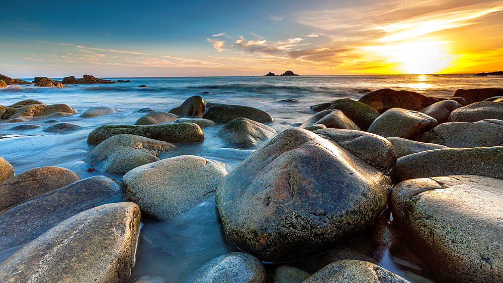 Sunset over the Porth Nanven, a rocky cove near Land's End, Cornwall, England, United Kingdom, Europe.
