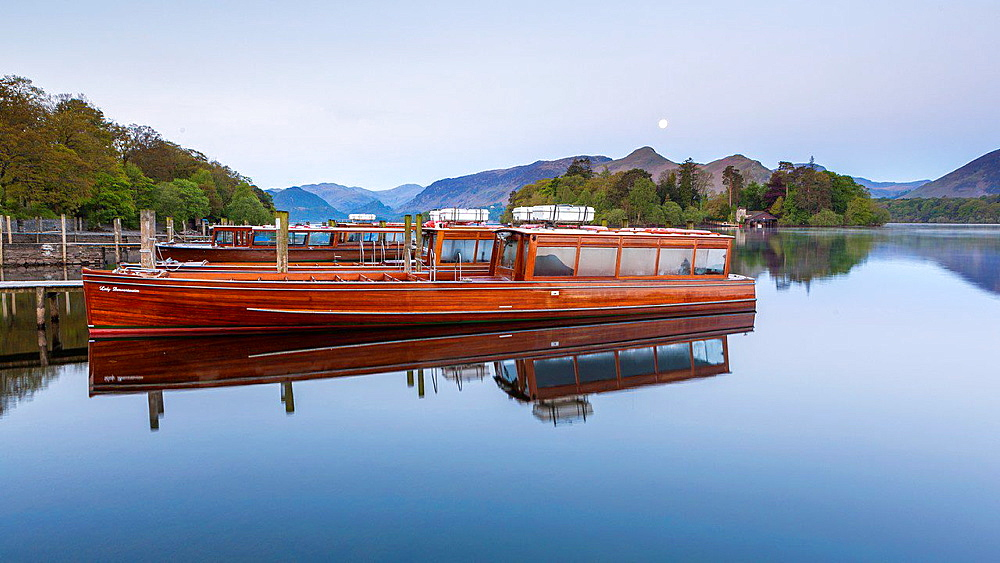 Boats on Derwent Water at sunrise, Keswick, Lake District National Park, Cumbria, England, UK, Europe.