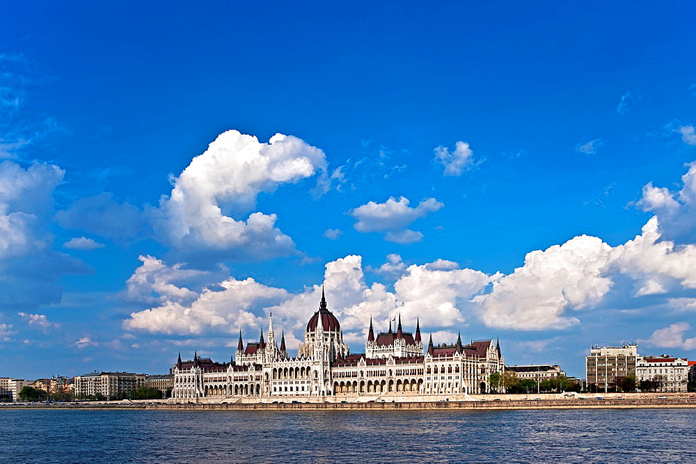 View over the Danube river to the world largest parliament, 268m long, 118m wide and with 691 rooms, the dome is 96 meters high. Built from 1885-1904 by architect Imre Steindl in the neo-Gothic style Budapest, Hungary, Europe.