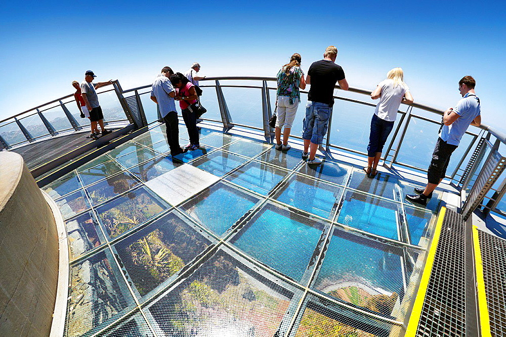 Tourists on the panoramic terrace (with glass floor) at the top of Cabo Girao (580 m highest) cliff, Camara de Lobos, Madeira, Portugal.