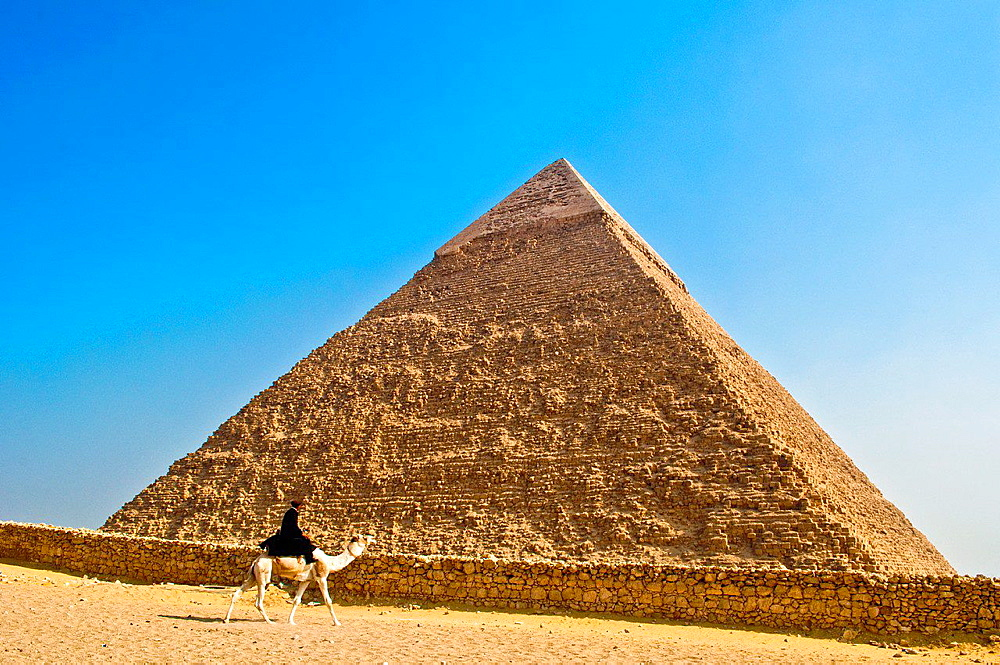 Riding a camel in front of Pyramid of Kefren.
