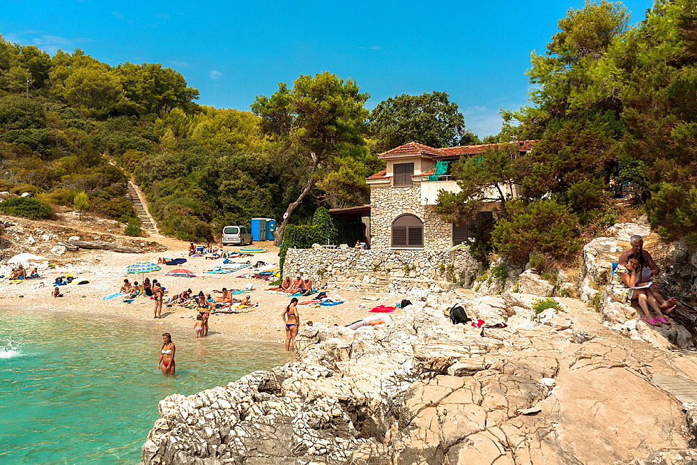 People relaxing at Zitna beach near Zavalatica, Croatia.