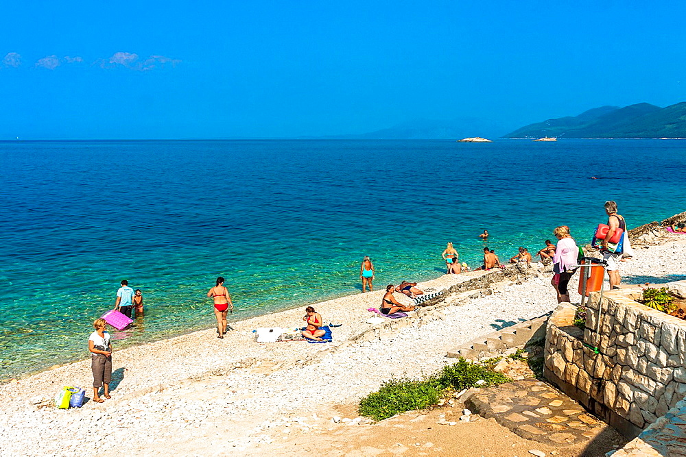 People on a beach in Prigradica village, Korcula island, Croatia.