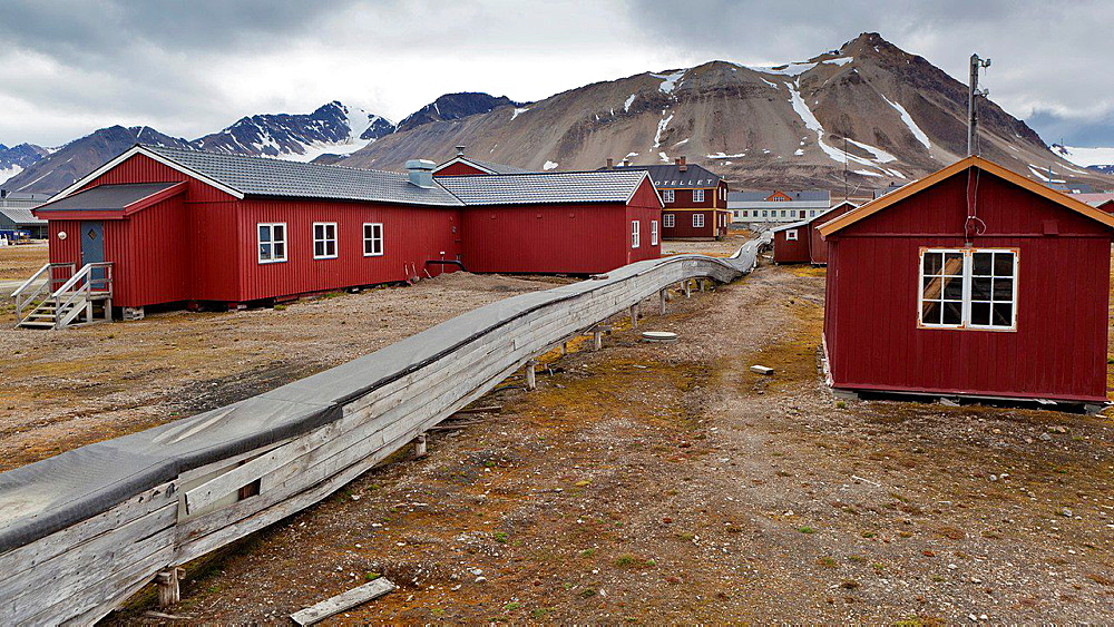 Scientific research stations with supply pipeline, Ny Alesund, Spitsbergen, Norway. Wood covers the pipeline to protect it from perm frost and arctic conditions.