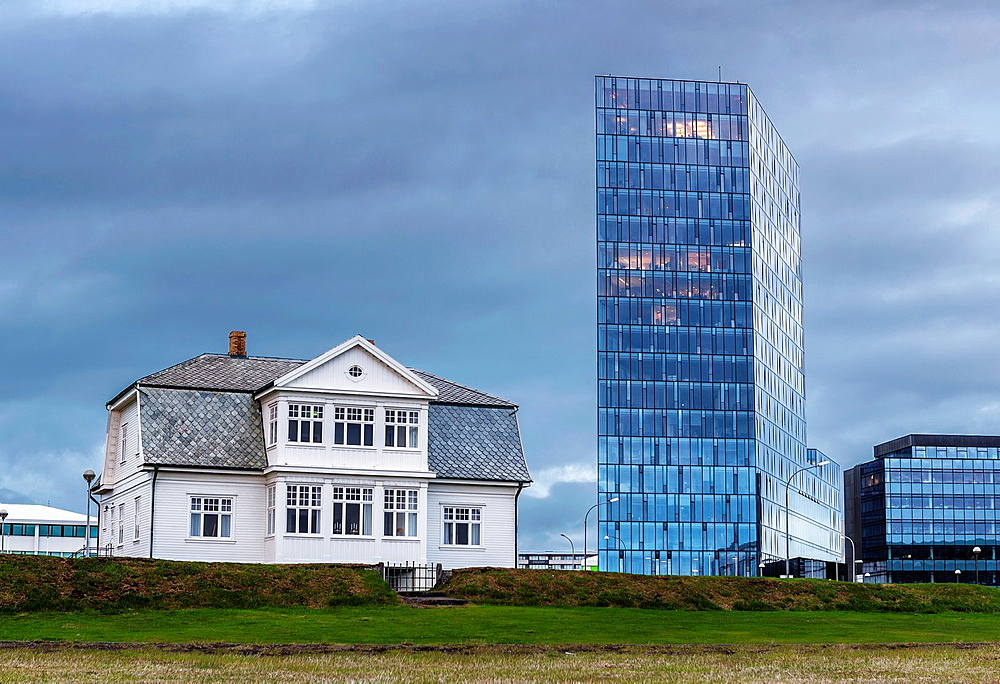 Hofdi House with new glass modern building, Reykjavik, Iceland.