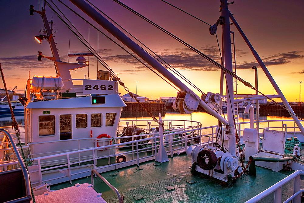 Ship in the harbor with the Midnight Sun, Olafsvik, Snaefellsnes Peninsula, Iceland.