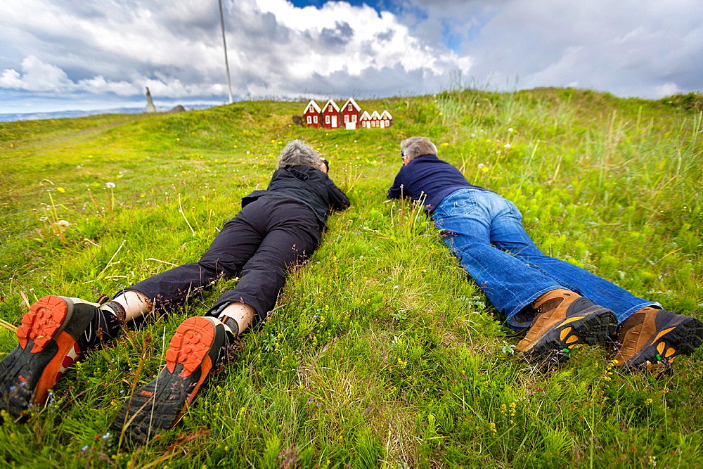 Taking pictures in the grass, Iceland.