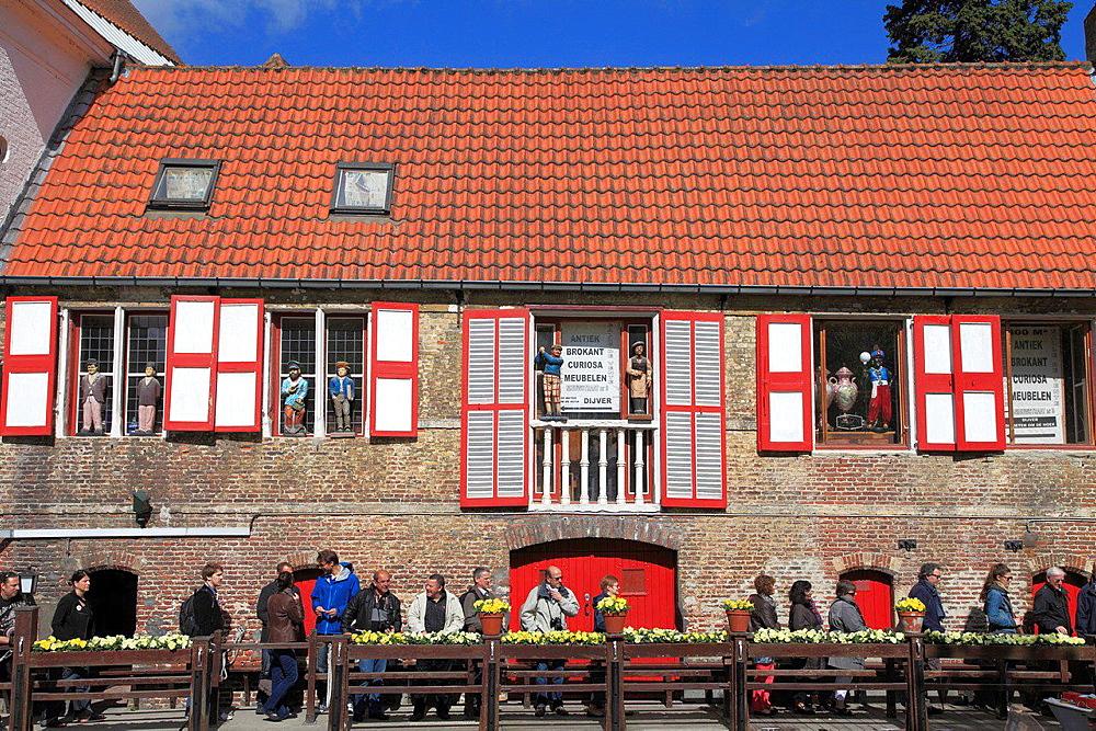Belgium, Bruges, street scene, curio shop, people.
