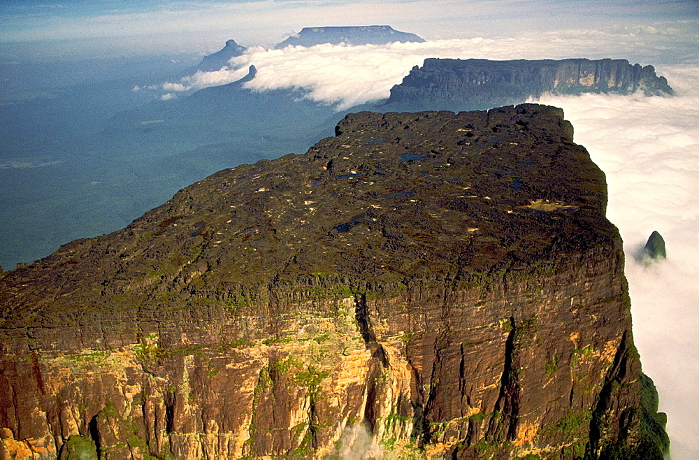Aerial view of the northern section of Cukenan-Tepuy with Yuruani-tepuy and Ilu-tepuy in the background. Canaima National Park, Bolivar State, Southern Venezuela.