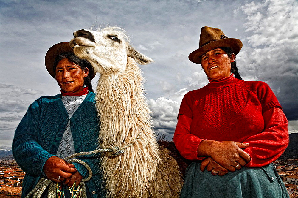 Native peruvian with alpaca in cusco, peru. - 817-462140