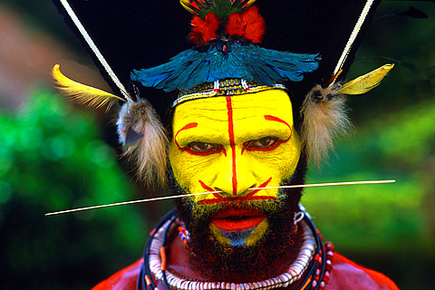 Colorful Huli Wigmen with Yellow Face In Papua New Guinea.