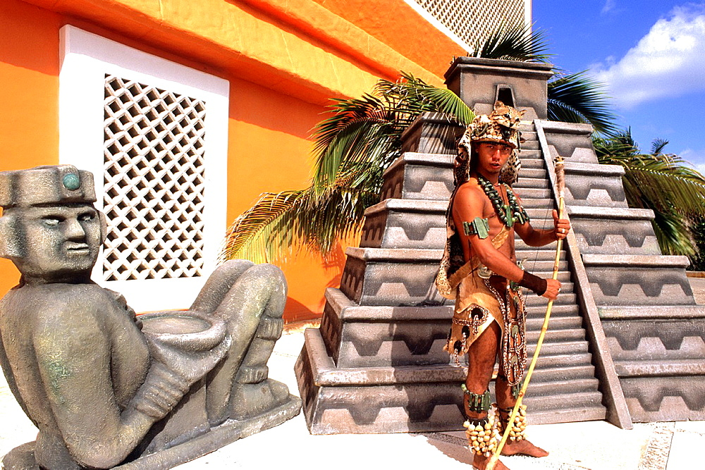 Mayan native in colorful costume in Cozumel Mexico.