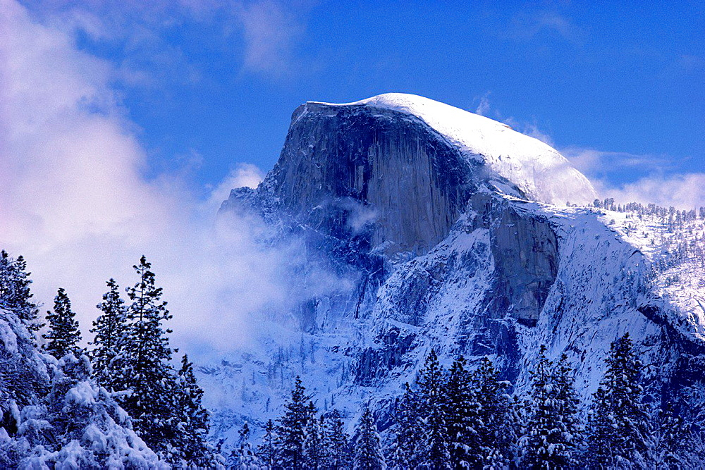 Fresh powder on Half Dome after a winter storm, Yosemite National Park, California USA.