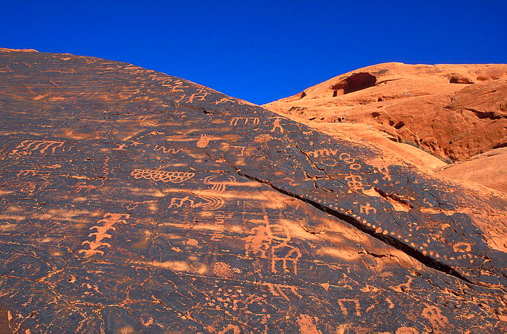 Anasazi petroglyphs on sandstone, Valley of Fire State Park, Nevada USA.