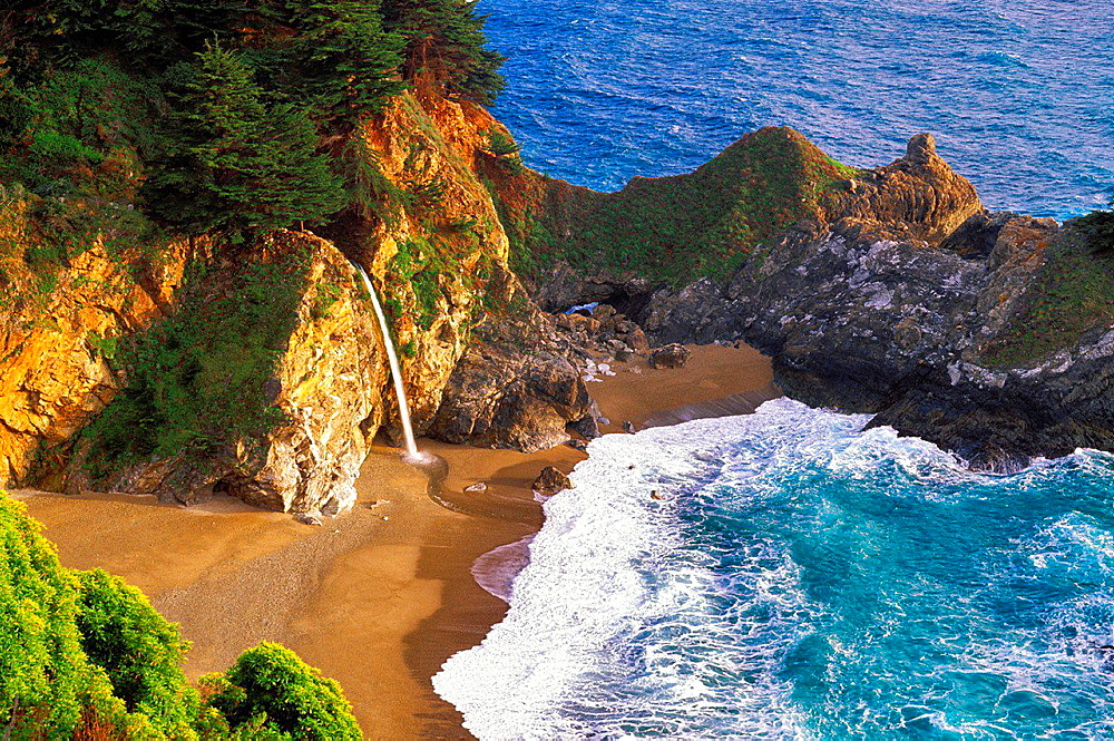 Evening light on McWay Cove and Waterfall, Julia Pfeiffer Burns State Park, Big Sur Coast, California USA.