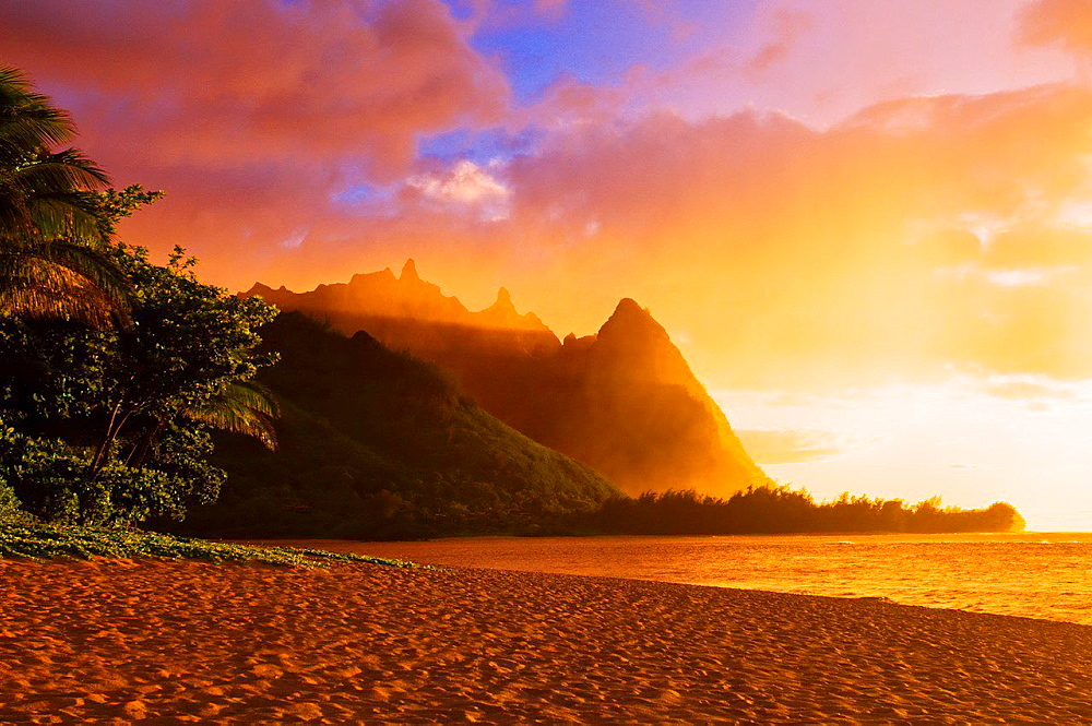 Evening light on Na Pali Coast spires from Tunnels Beach, Island of Kauai, Hawaii USA.