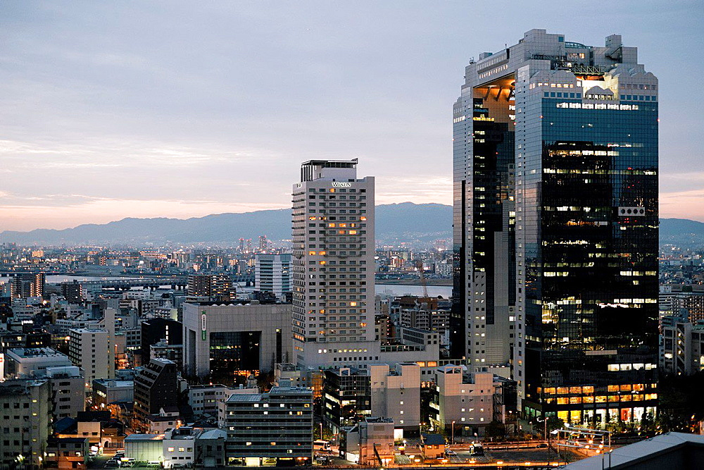 An evening view of the Umeda Sky Building, designed by Hiroshi Hara in Osaka, Japan.