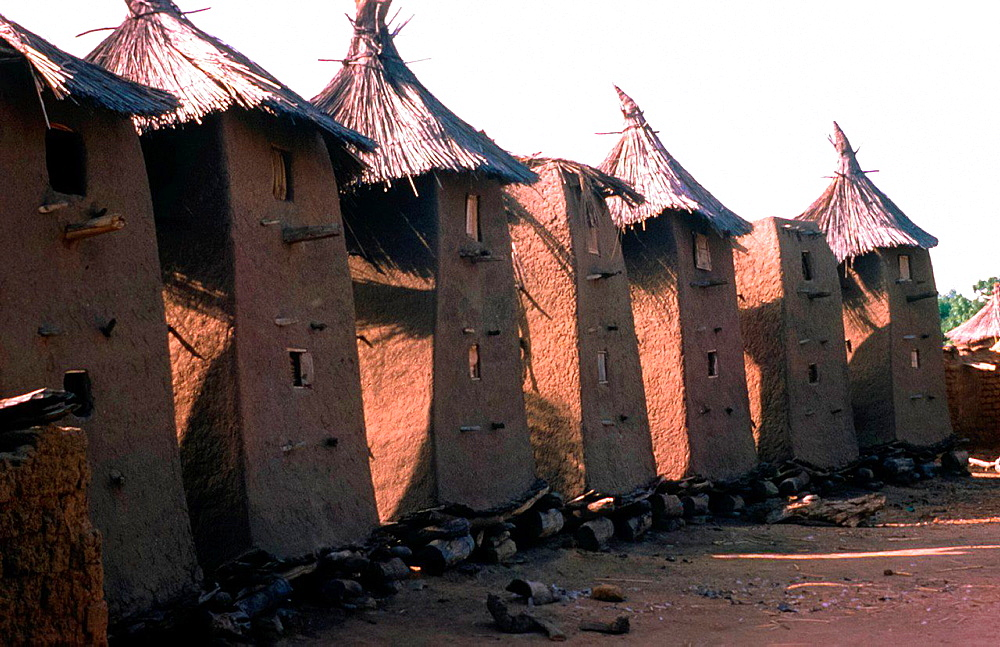 row of typical shaped granaries in a village in Mail, Africa