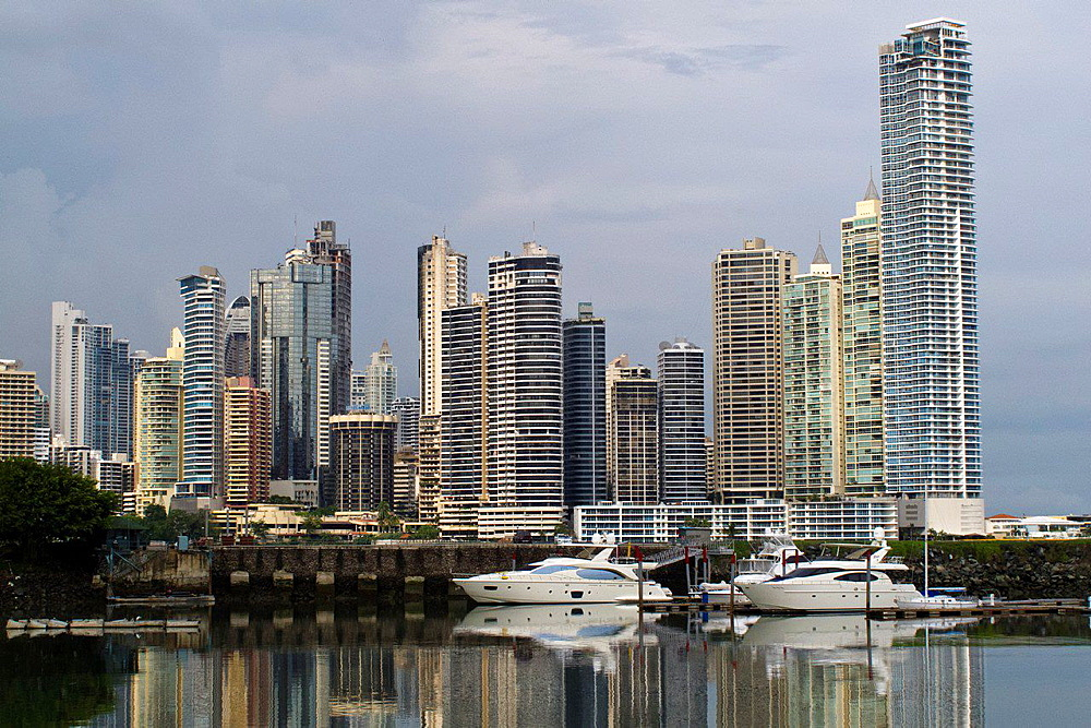 General view of sky scrapers, skyline with bay, water view and boats, Panama City, Panama.