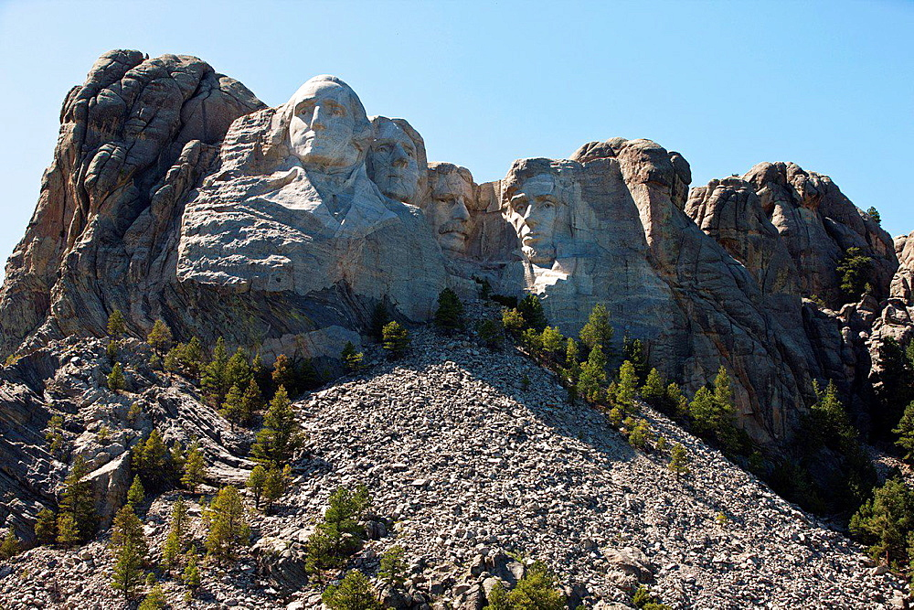 General view Mt. Rushmore with sculptures of former presidents George Washington, Thomas Jefferson, Theodore Roosevelt, and Abraham Lincoln, Mount Rushmore National Monument, South Dakota, United States of America.