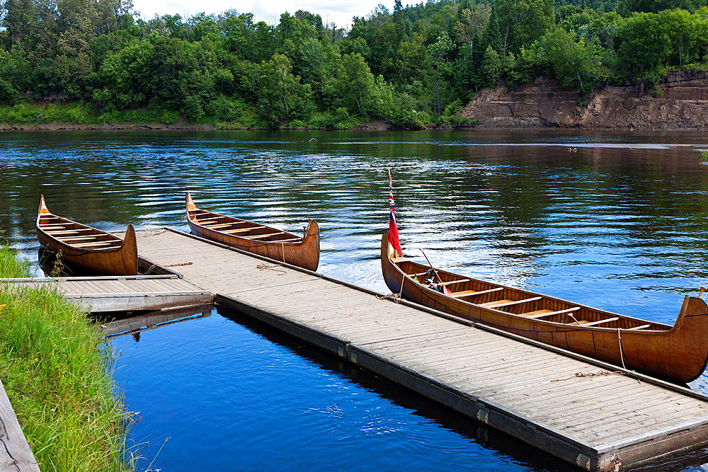 Canoes tied to a floating dock, Fort William Historical Park, Thunder Bay, Ontario, Canada.