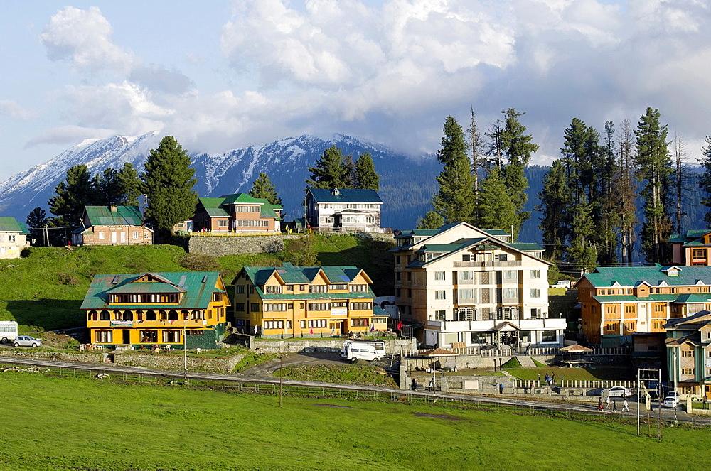 Hotels and Himalayan range, Gulmarg, Jammu & Kashmir, India.