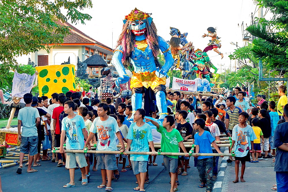 Children carrying Monster Figures at the Nyepi New Years Festival in Jimbaran on Bali, Indonesia.
