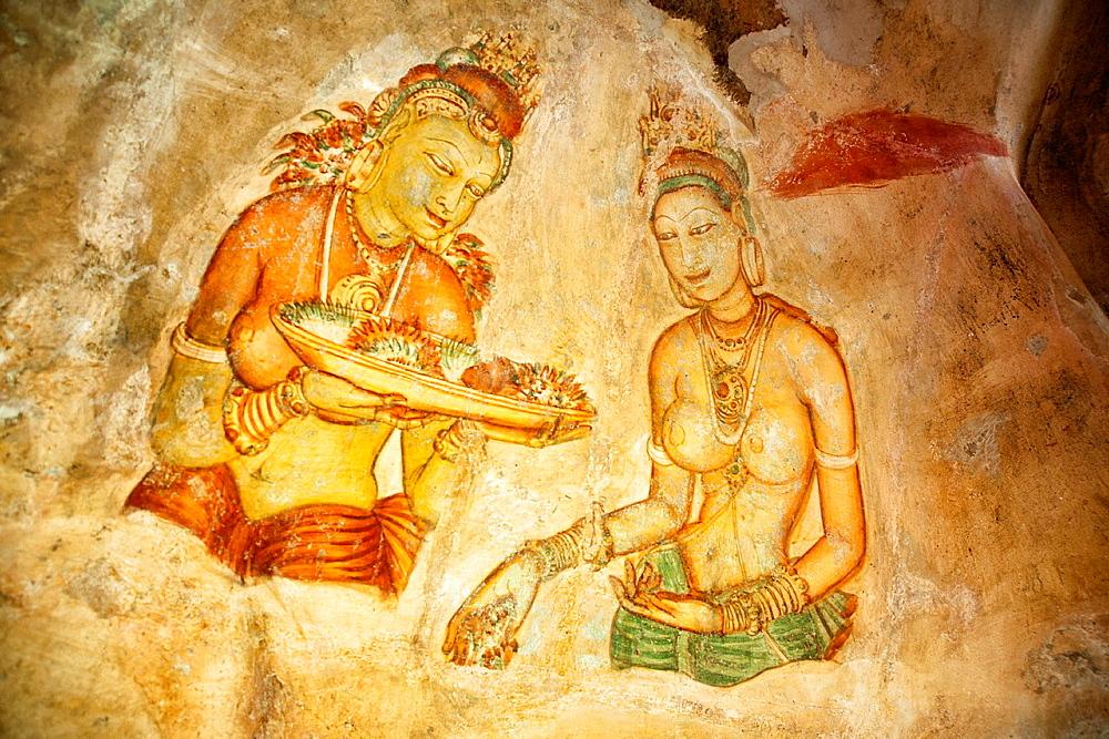 Apsara frescoes at Sigiriya Rock, King Kassapa's palace fortress AD 477-495, UNESCO site, Sigiriya, Sri Lanka, Asia.