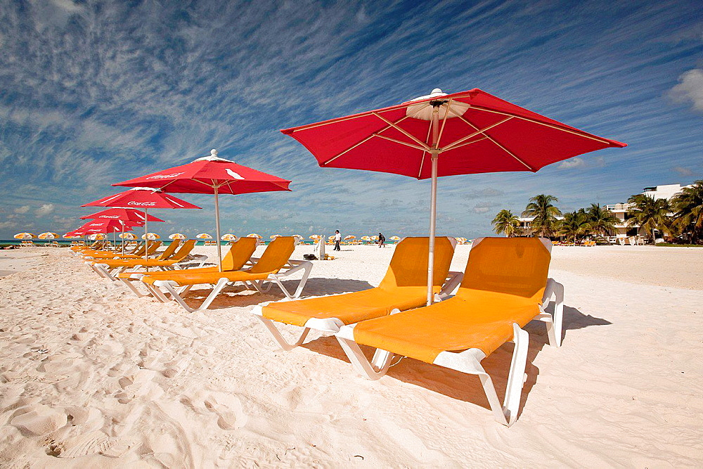 Parasols and deckchairs on the beach, Isla Mujeres, Quintana Roo, Yucatan, Mexico.