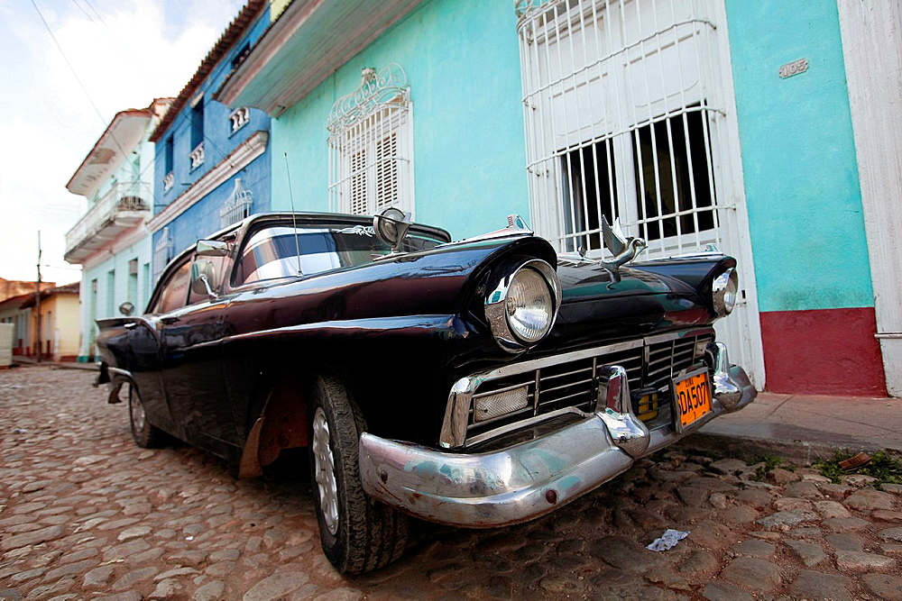 Old american car parked at the street side, Trinidad, Cuba, Central America.