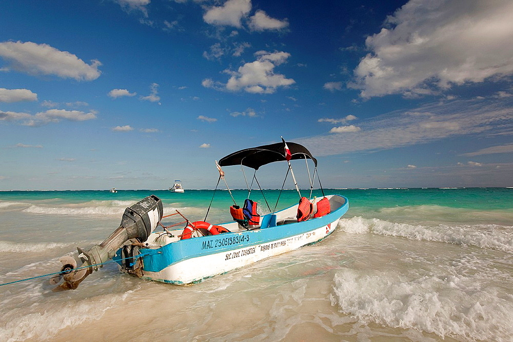 Fishing Boat moving at Tulum beach on a windy day, Tulum, Quintana Roo, Mexico.