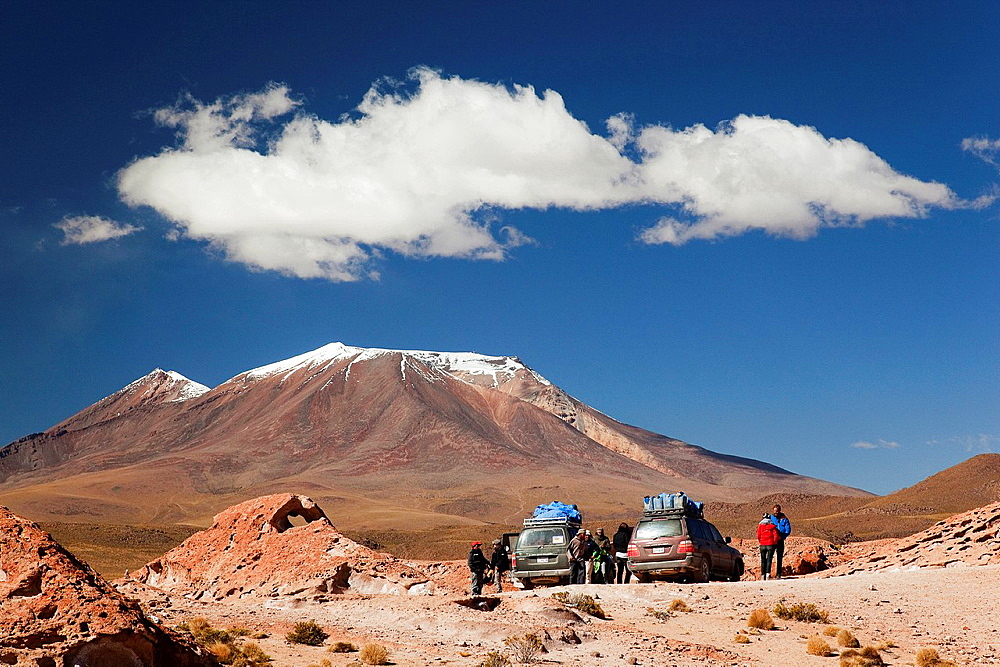 Tourists and guides near the 4x4 jeeps during a break, Salar de Uyuni, Southern Altiplano, Bolivia.