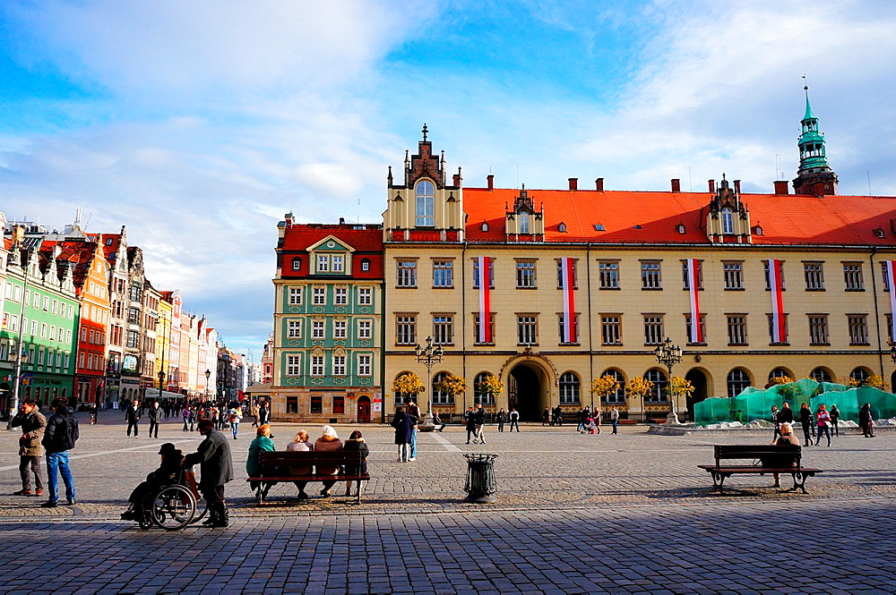 Wroclaw, Poland, November 10, 2013, Sitting and walking people close by the new city hall in the old square of the citi.