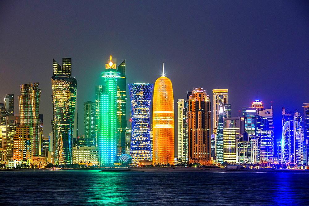 Qatar, Doha City, The Corniche, West Bay Skyline at sunset.