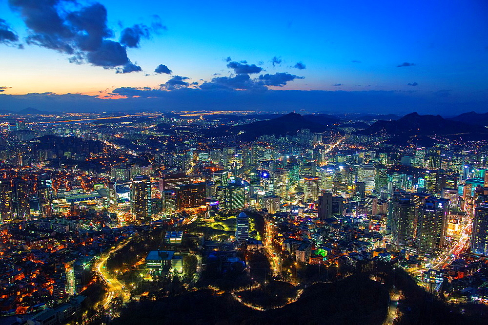 Korea, Seoul City, Myeong-dong District at sunset, Central Seoul.