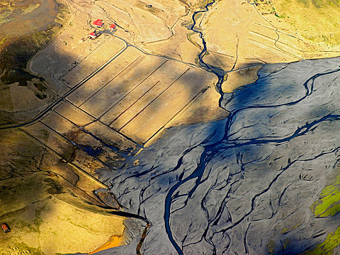Aerial view of fields and river delta, South Iceland