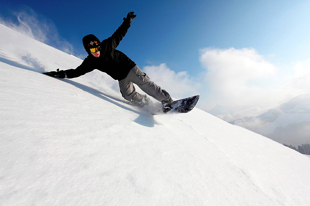 Snowboarder going down mountain