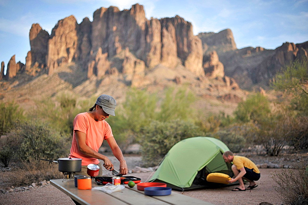 Backpacking couple making camp, Apache Junction, Arizona, USA