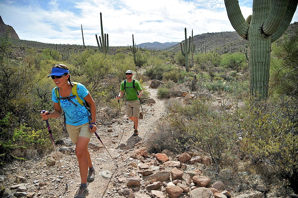Backpacking couple hiking, Apache Junction, Arizona, USA