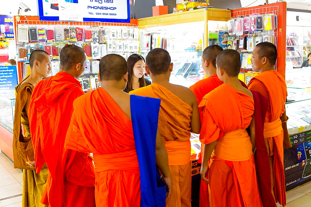 Seven monks in a mobile phone shop in Vientiane, Laos.