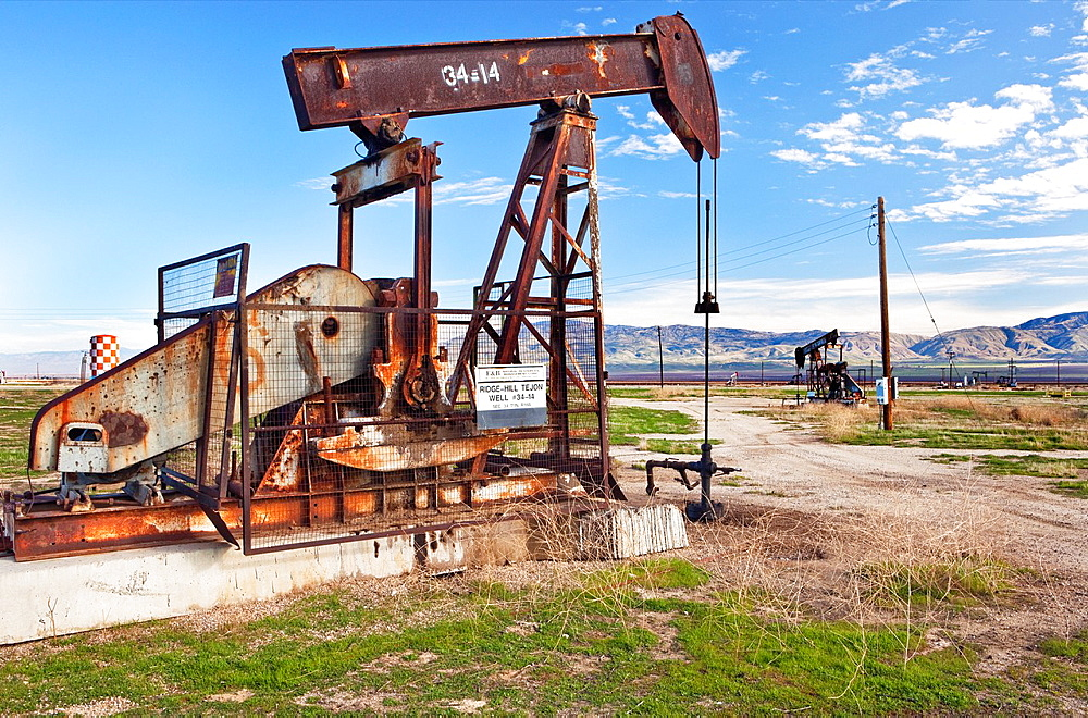 Abandoned oil well w pump at Kern Co. Californa.