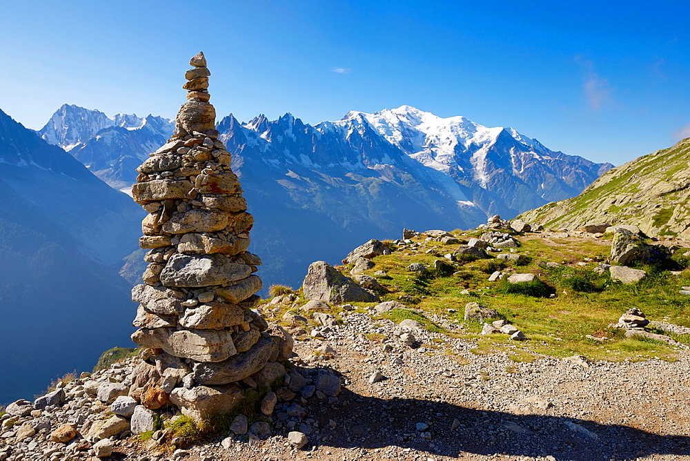 Cairn, at background can be seen the Mont Blanc Peak, Mont Blanc Masif, Alps, Chamonix, France.