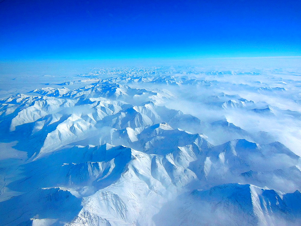 Alaskan Mountains Seen During IceBridge Transit. Alaskan mountains seen from high altitude aboard the NASA P-3B during the IceBridge transit flight from Thule to Fairbanks on March 21, 2013.
