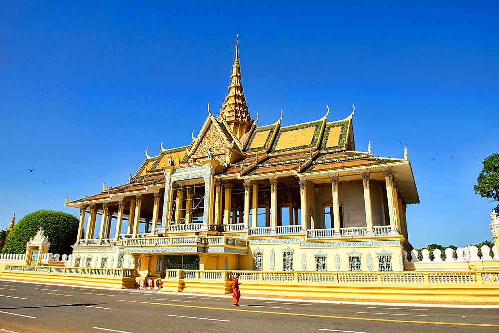 monk walks in front of the Chan Chhaya Pavilion at the Royal Palace in Phnom Penh, Cambodia.