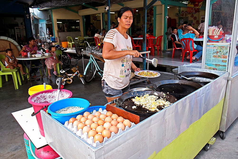 Vendor selling fried oyster pancake at Kampung Pulau Ketam Crab Island fishing village, Malaysia.