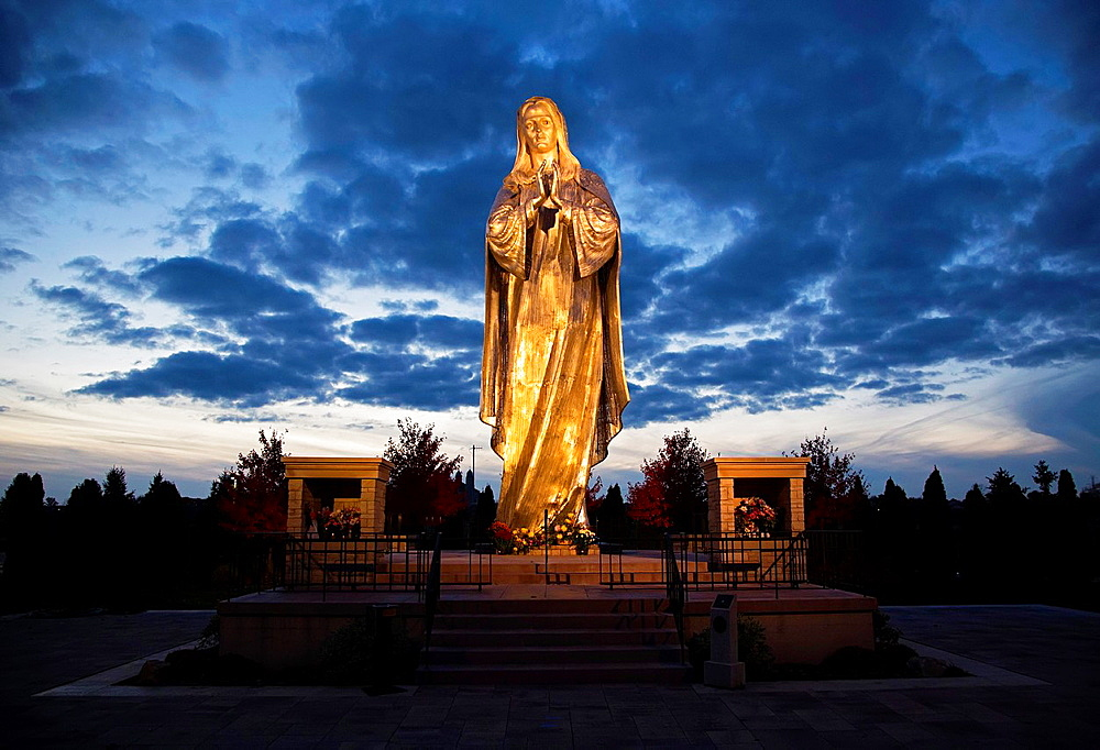 St. John, Indiana, Our Lady of the New Millennium, an 8400-pound, 33-foot tall stainless steel statue of the Virgin Mary. It is on display at the Shrine of Christ's Passion near St. John the Evangelist Roman Catholic church.