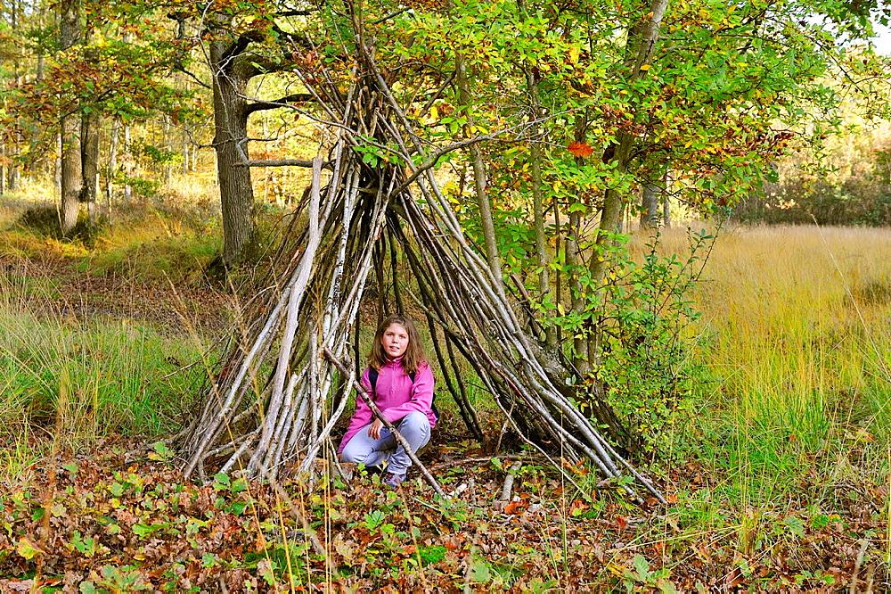 little girl under an hut, Forest of Rambouillet, Yvelines department, Ile-de-France region, France, Europe