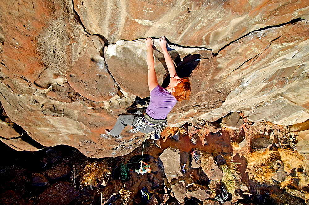 Jocelynn Smith rock climbing a route called Casual Cruise which is rated 5,10 and located on the North Shore at Dierkes Lake near the city of Twin Falls in southern Idaho.