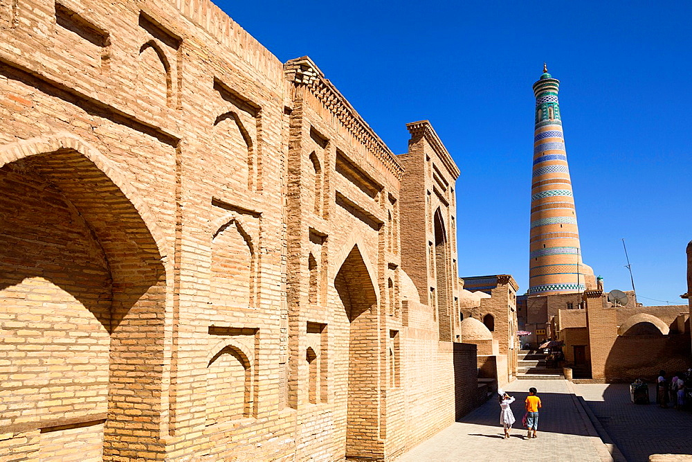 Pahlavan Mahmud Mausoleum on left and Islam Khodja Minaret, Ichan Kala, Khiva, Uzbekistan.